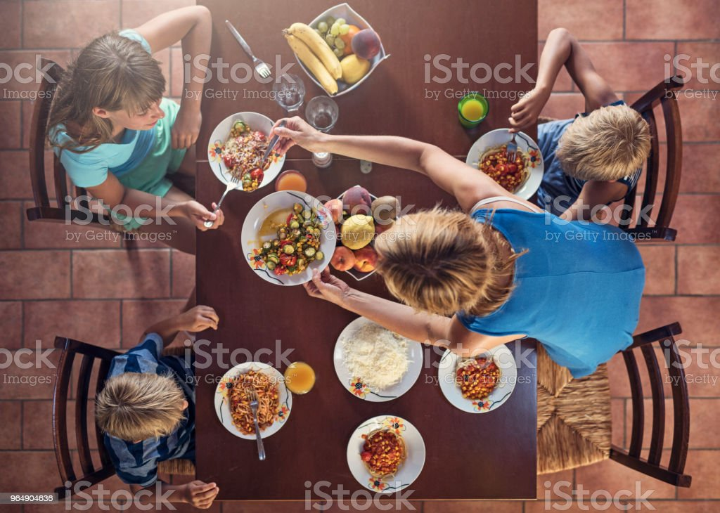 Family enjoying italian food lunch royalty-free stock photo