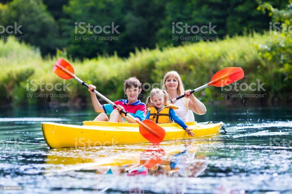 Family enjoying kayak ride on a river stock photo
