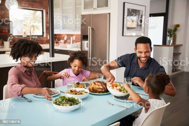 Family enjoying meal around table at home together picture id992108418?b=1&k=6&m=992108418&s=612x612&h=ecajpx4c 2tznowqmshgfcorvqdp 1ayzp97l27njri=