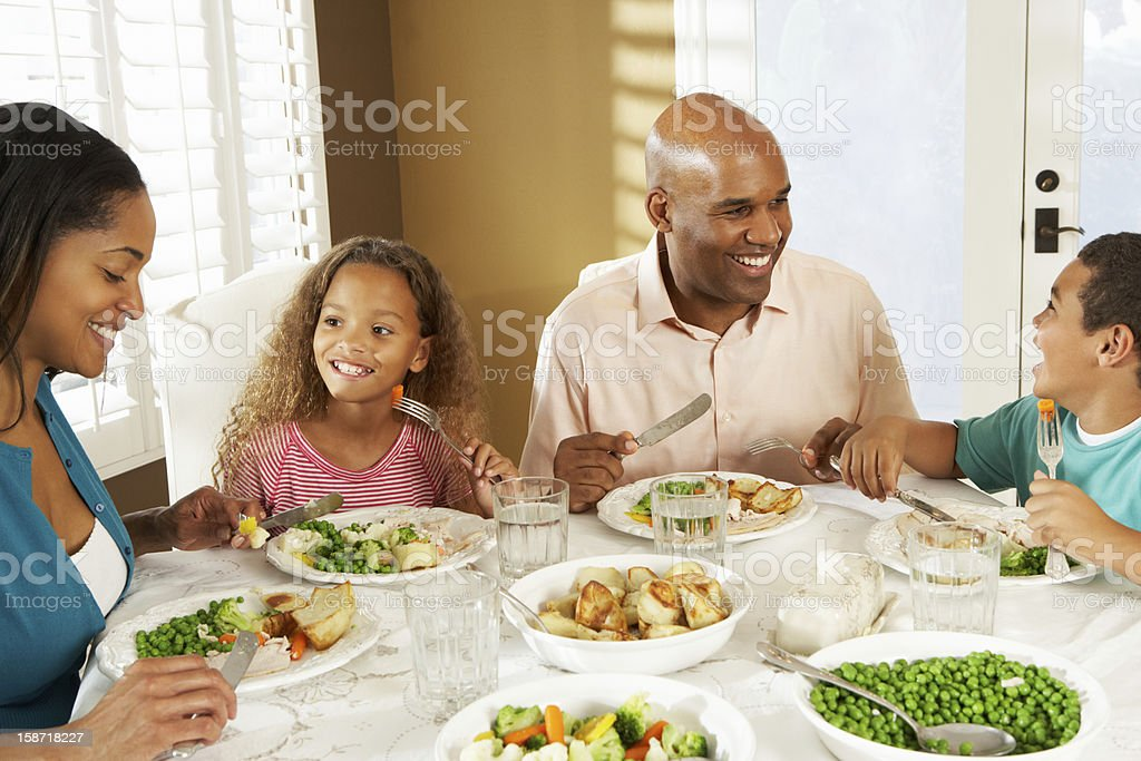 Family Enjoying Meal At Home stock photo
