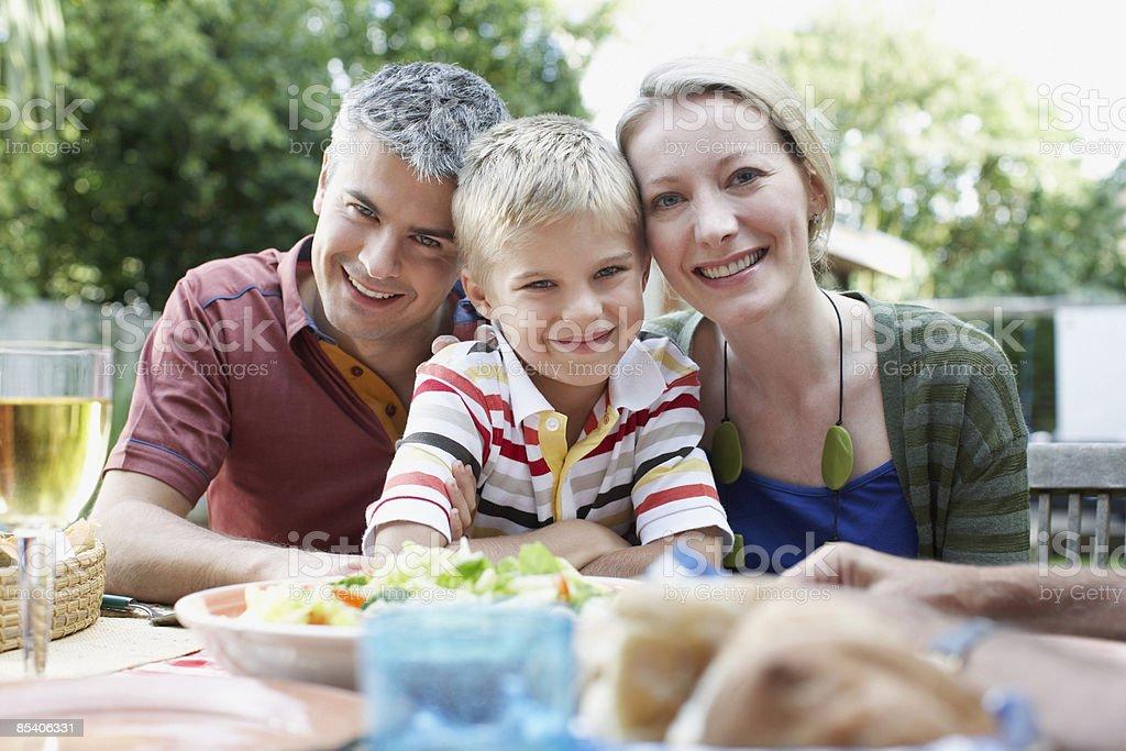 Family enjoying picnic in backyard stock photo