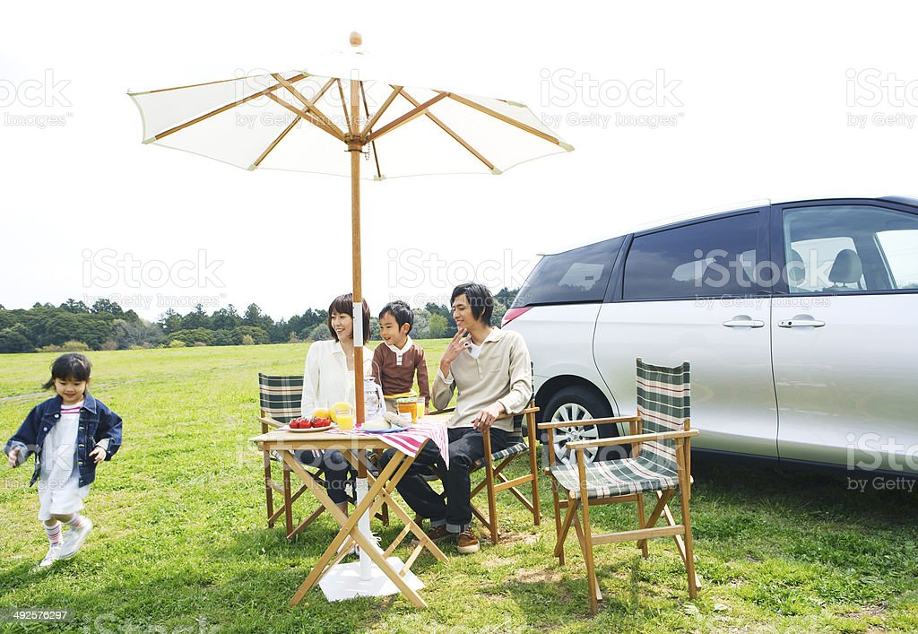 Family enjoying picnic in prairie stock photo