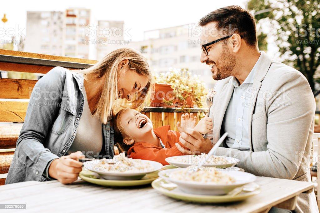 Family enjoying restaurant royalty-free stock photo