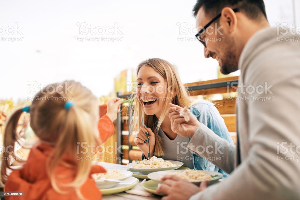 Family enjoying restaurant stock photo