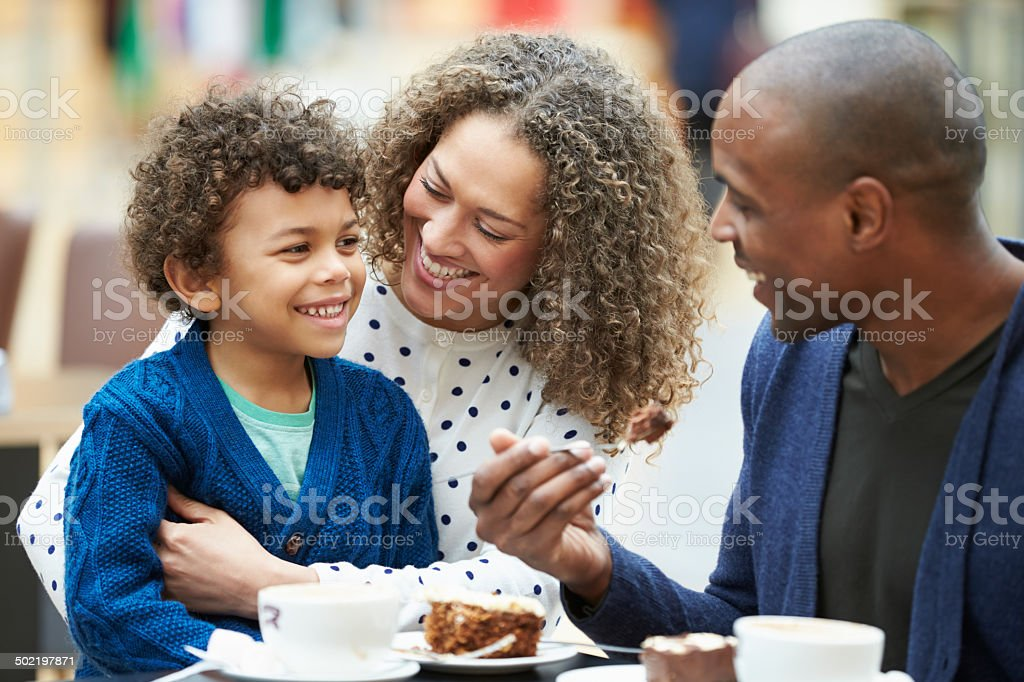 Family Enjoying Snack In CafeŽ Together stock photo