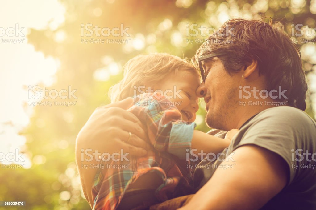 Family enjoying summer in park stock photo