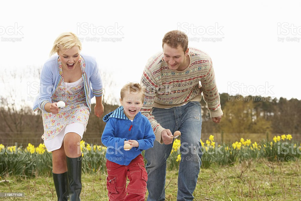 Family enjoying the egg and spoon race stock photo