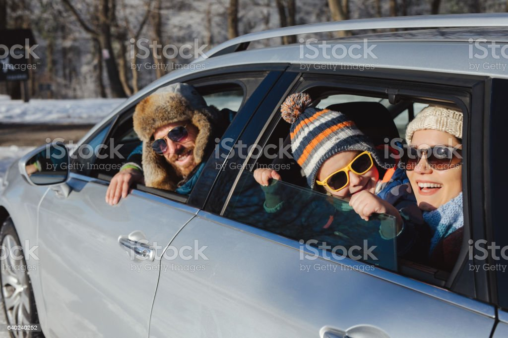 Family enjoying the ride to mountain forest by car stock photo