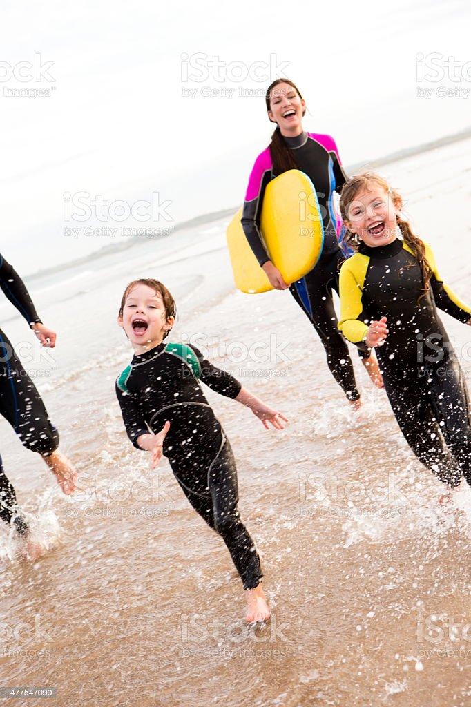 Family enjoying the surf stock photo