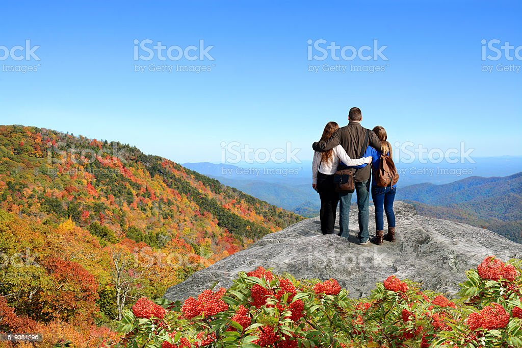 Family enjoying time in the mountains on vacation. stock photo