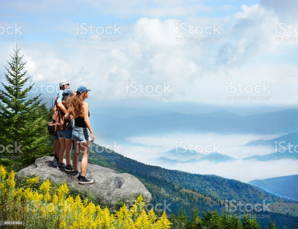Family  enjoying time together on hiking trip in the mountains. stock photo