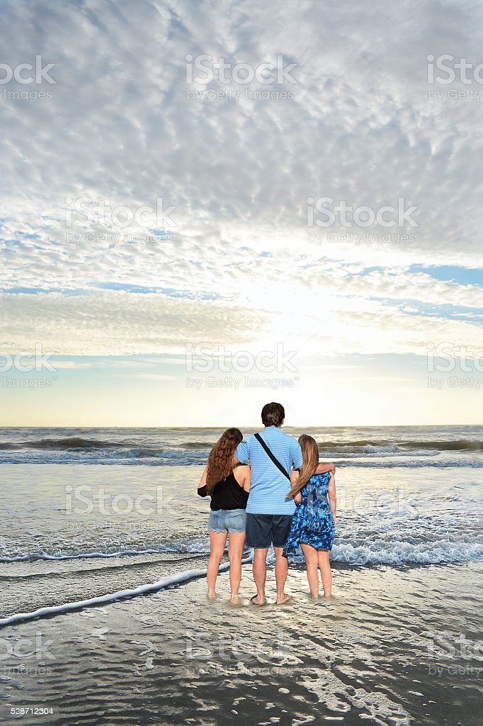 Family enjoying time together on the beach stock photo