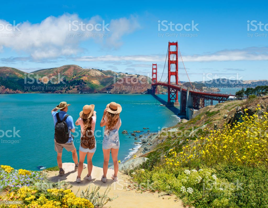 Family enjoying time together on vacation hiking trip. stock photo