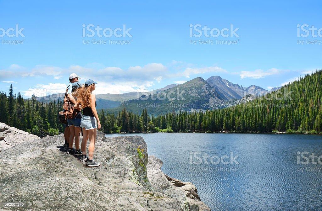 Family enjoying together hiking trip. stock photo