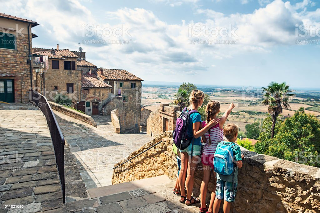 Family enjoying view in little Italian town in Tuscany stock photo