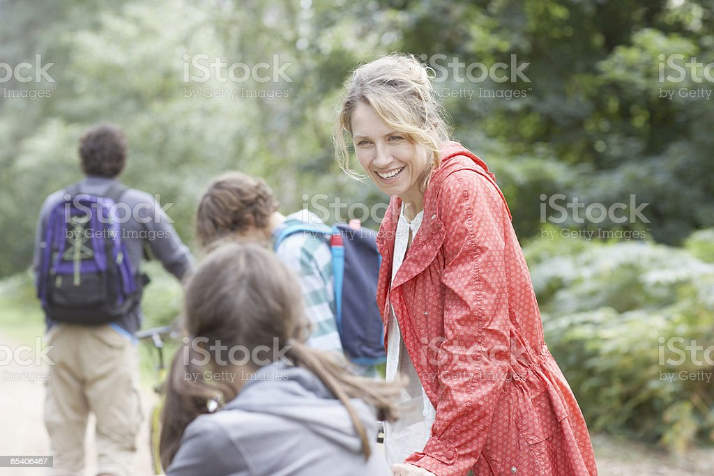 Family enjoying walk in the woods stock photo