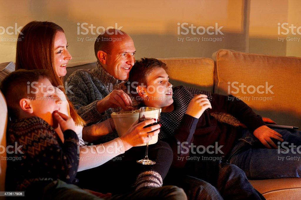 Family enjoying watching television stock photo