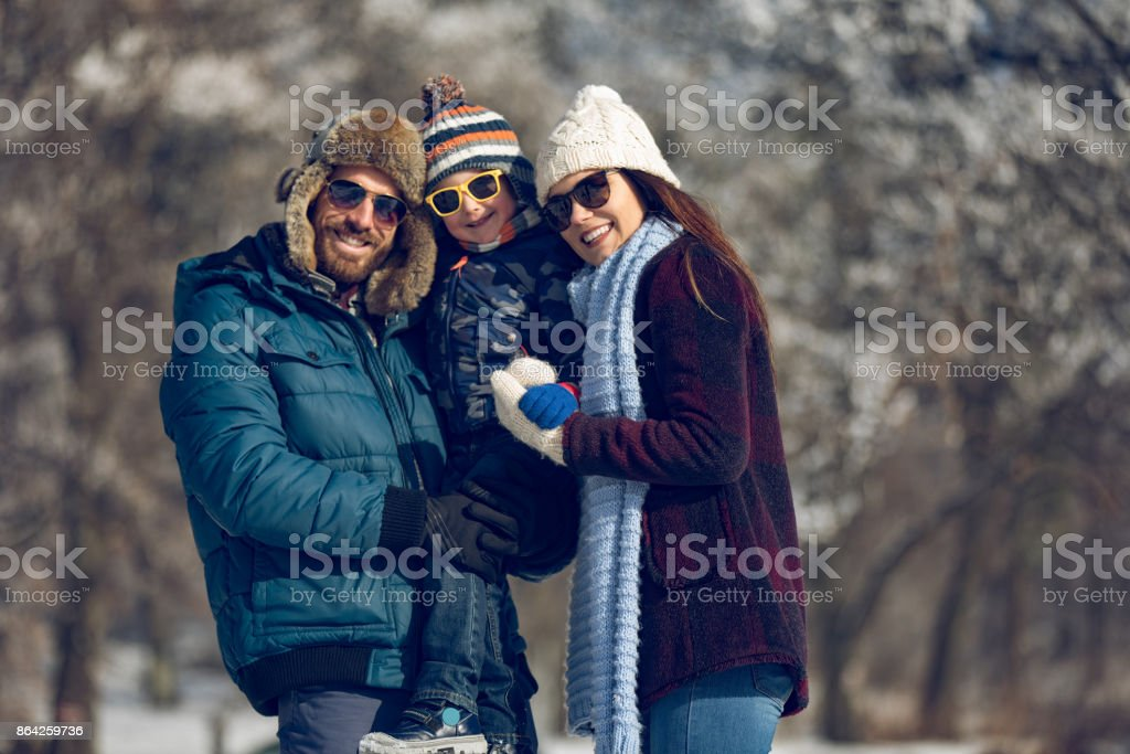 Family enjoying winter day in the forest royalty-free stock photo
