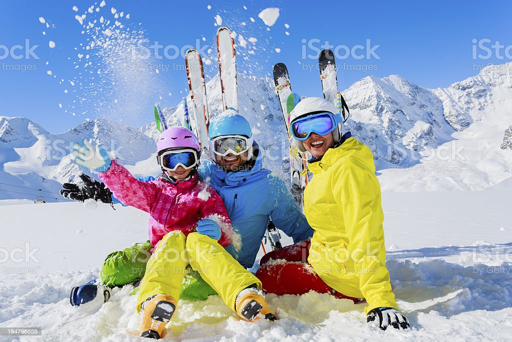 Family enjoying winter ski vacation stock photo