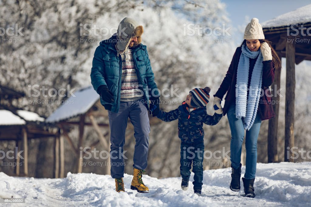 Family enjoying winter walk in the forest. royalty-free stock photo