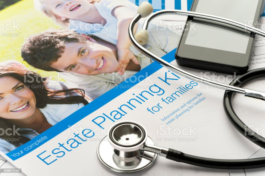 Family Estate planning document with stethoscope stock photo