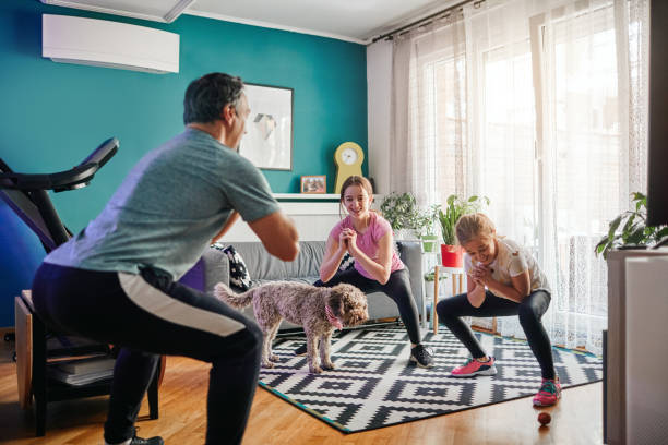 Family Exercise At Home stock photo