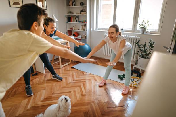 Family exercising at home picture id1222423152?b=1&k=6&m=1222423152&s=612x612&w=0&h=iaezry ljnsakr4rkkdjobyp9kcsuwyhnrhwb7fq3pk=