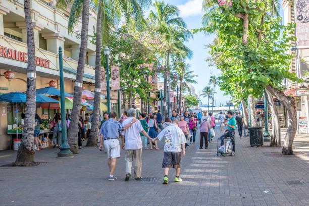 Family explores Chinatown in Honolulu. stock photo