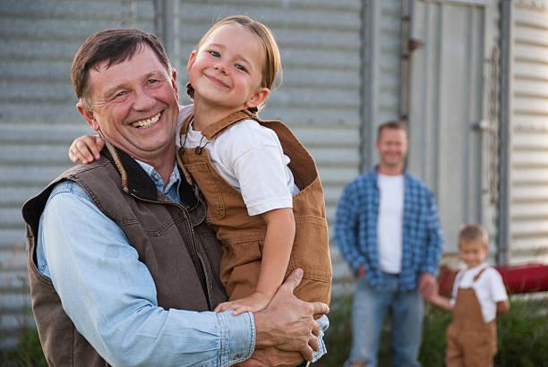 family farm - jeans overall stock-fotos und bilder