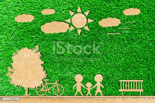 istock Family father mom and baby paper cut of bicycle sun tree cloud on a green background 893522758