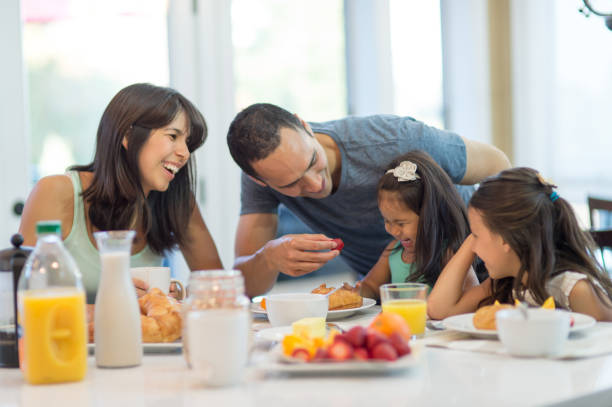 family feast - hawaiian ethnicity stock photos and pictures