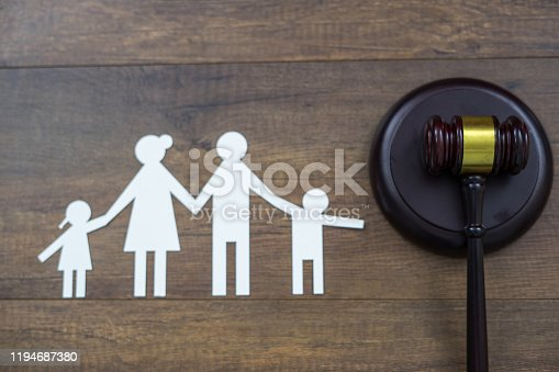 istock Family figure and gavel on table. Family law concept 1194687380