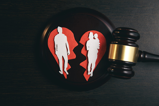 istock Family figure and gavel on table. Family law 1220733282