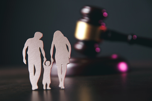 istock Family figure and gavel on table. Family law 1220733297