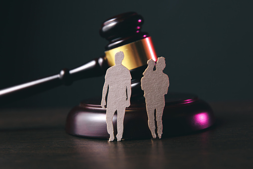istock Family figure and gavel on table. Family law 1220733311