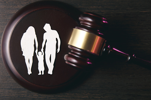 istock Family figure and gavel on table. Family law 1220733325
