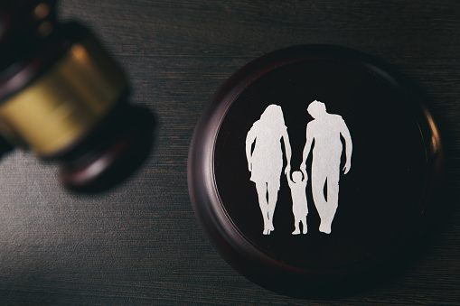 istock Family figure and gavel on table. Family law 1220733357