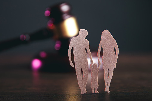 istock Family figure and gavel on table. Family law 1220733720