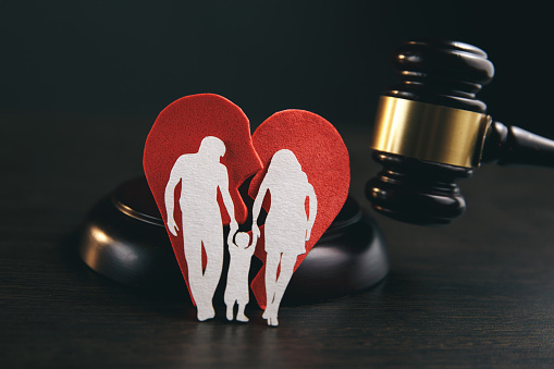 istock Family figure and gavel on table. Family law 1220733726