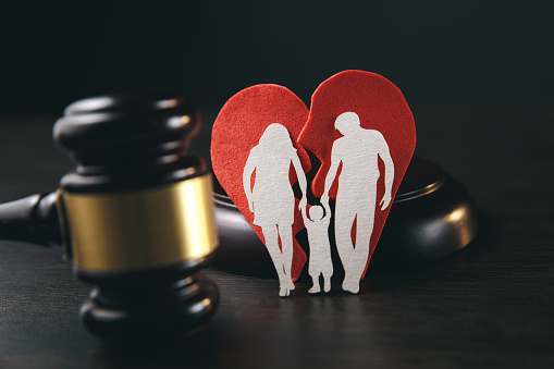 istock Family figure and gavel on table. Family law 1220738749