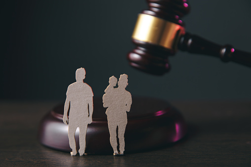 istock Family figure and gavel on table. Family law 1220738801