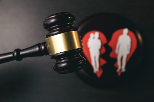 istock Family figure and gavel on table. Family law 1220738810