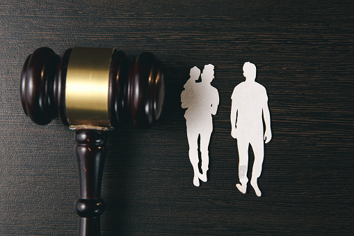 istock Family figure and gavel on table. Family law 1220740578