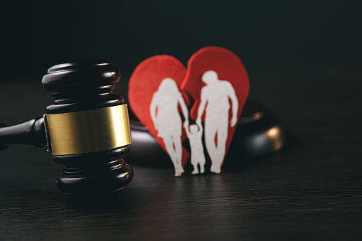 istock Family figure and gavel on table. Family law 1221564387