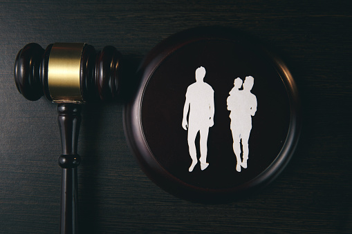 istock Family figure and gavel on table. Family law 1221564468