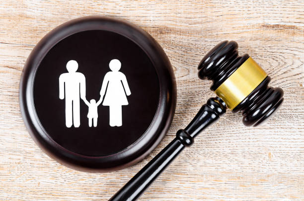 Family figure and gavel on table. stock photo