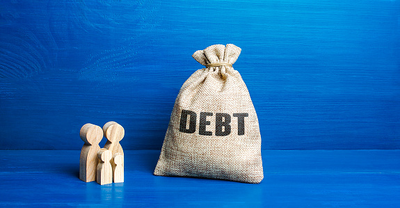 Family figurines and Debt money bag. Financial literacy. Arrears difficult financial situation. Debts restructuring. Inability to repay. Falling living standards, social complex. Refinancing