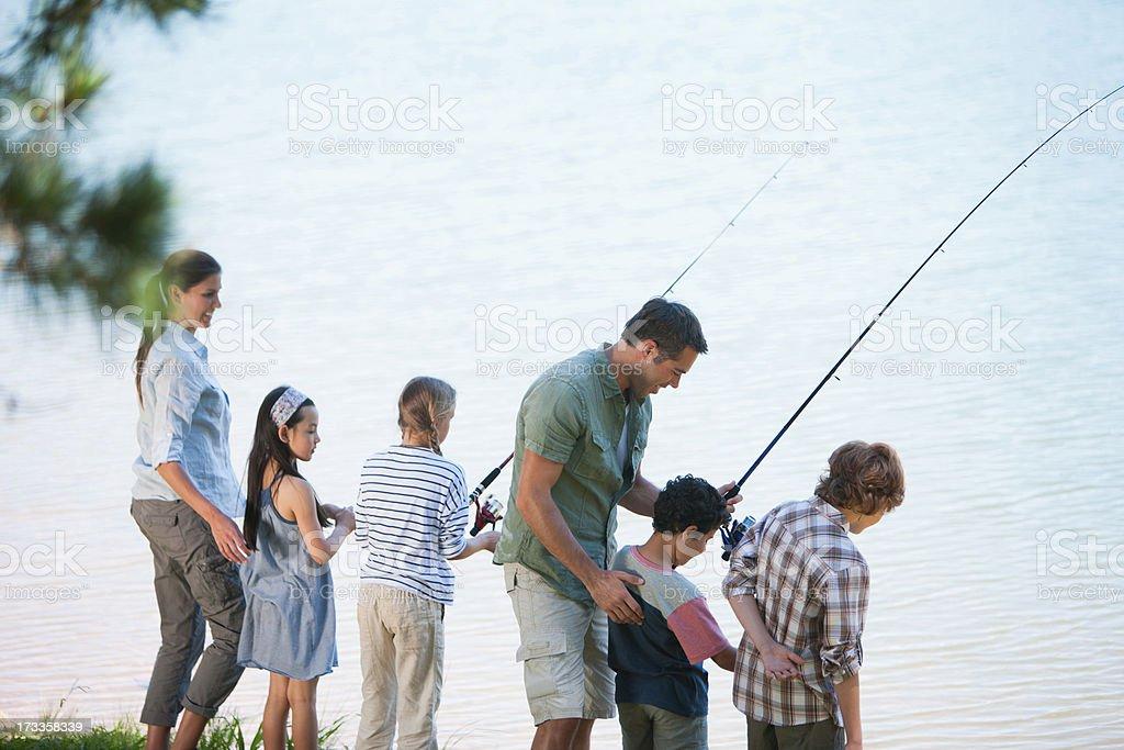Family fishing in lake stock photo