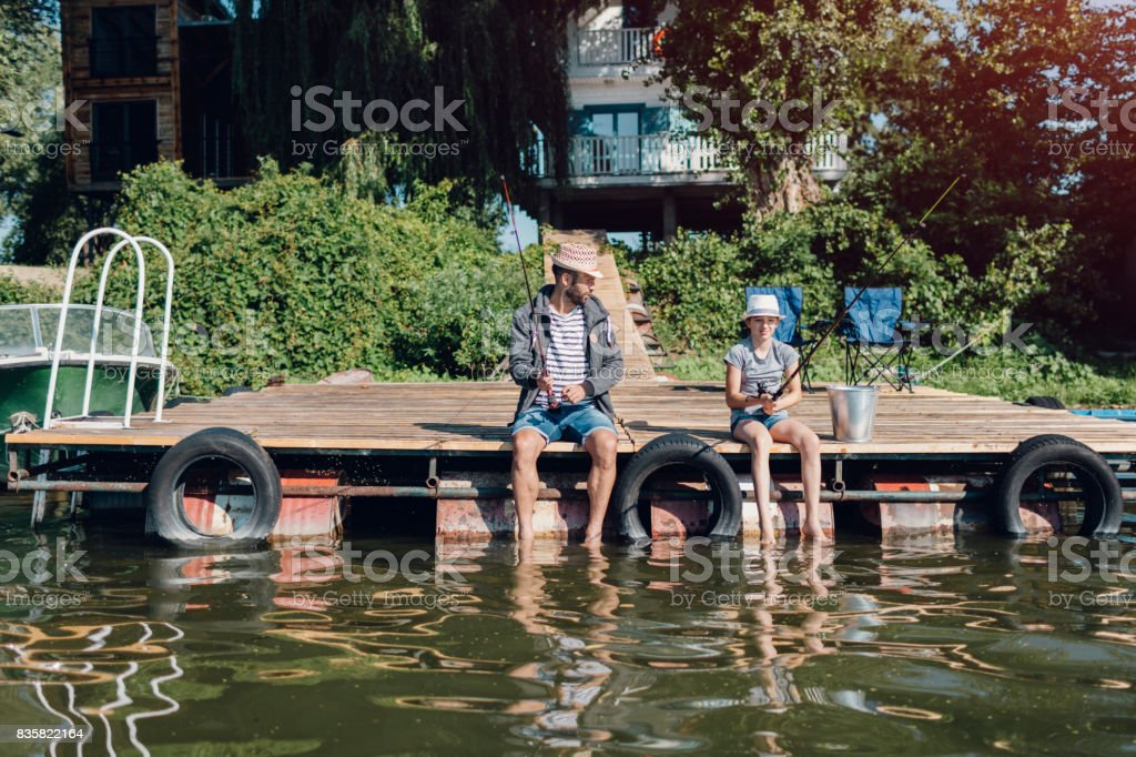 Family Fishing on Jetty stock photo