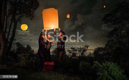 family flying lantern in Loy Krathong festival in Chiangmai